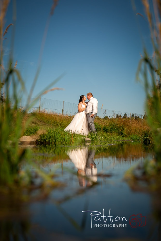 Bride and groom at the water edge