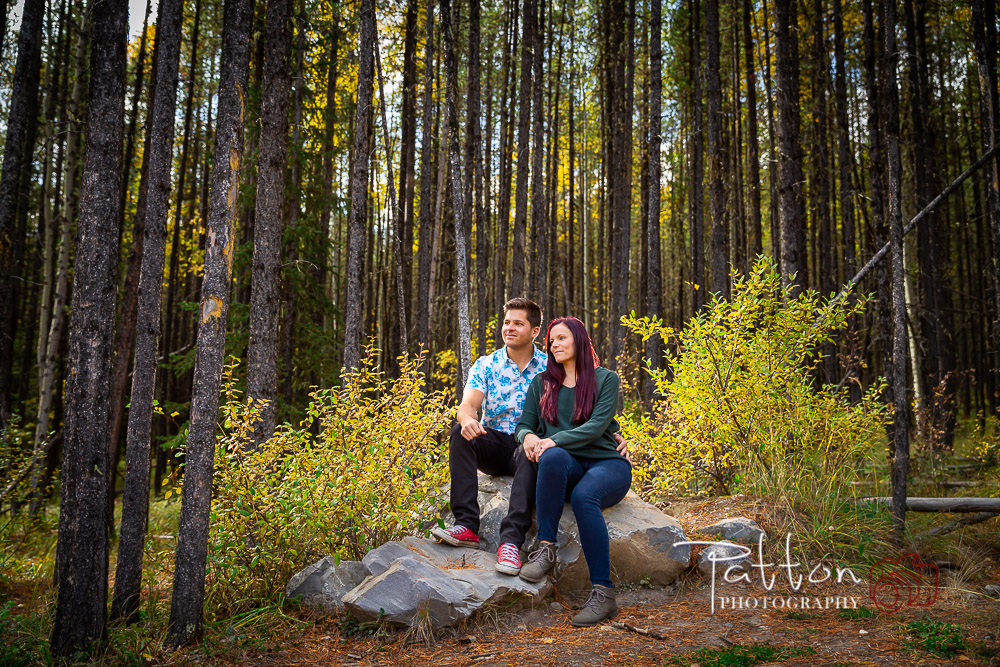 Engagement session with couple sat on rock