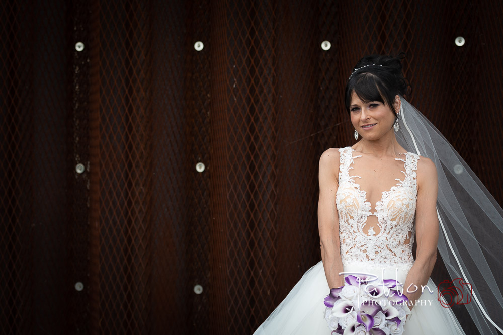 Calgary bride in front of metal textured wall