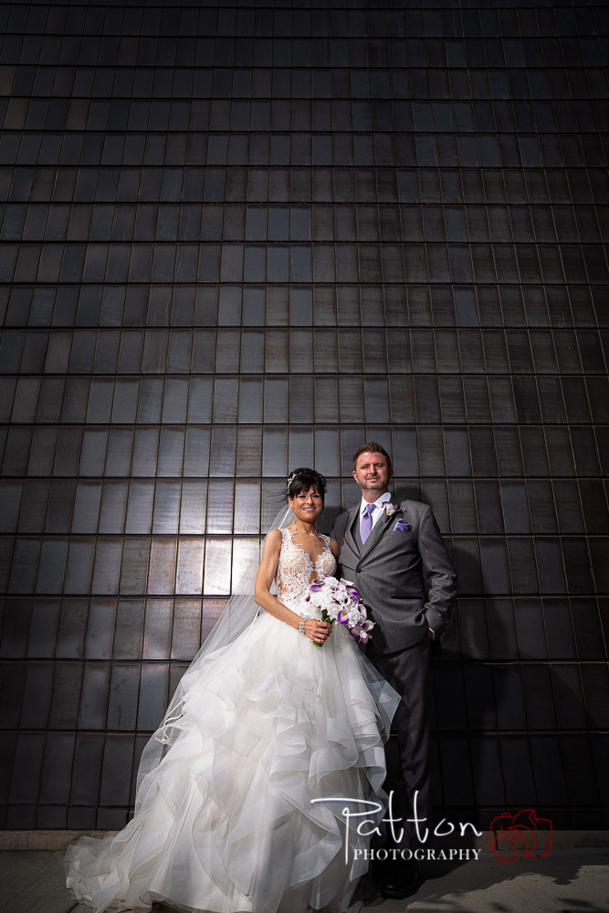 Calgary bride and groom in front of textured metal wall
