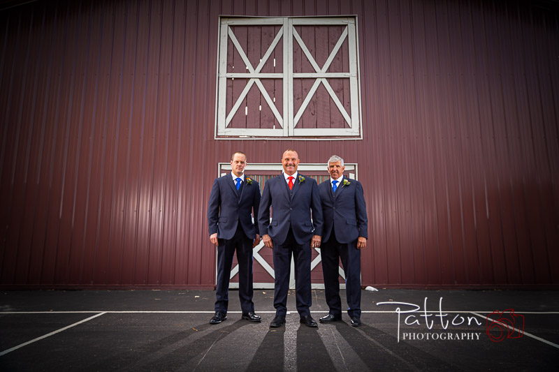 Calgary groomsmen at wedding in front of barn