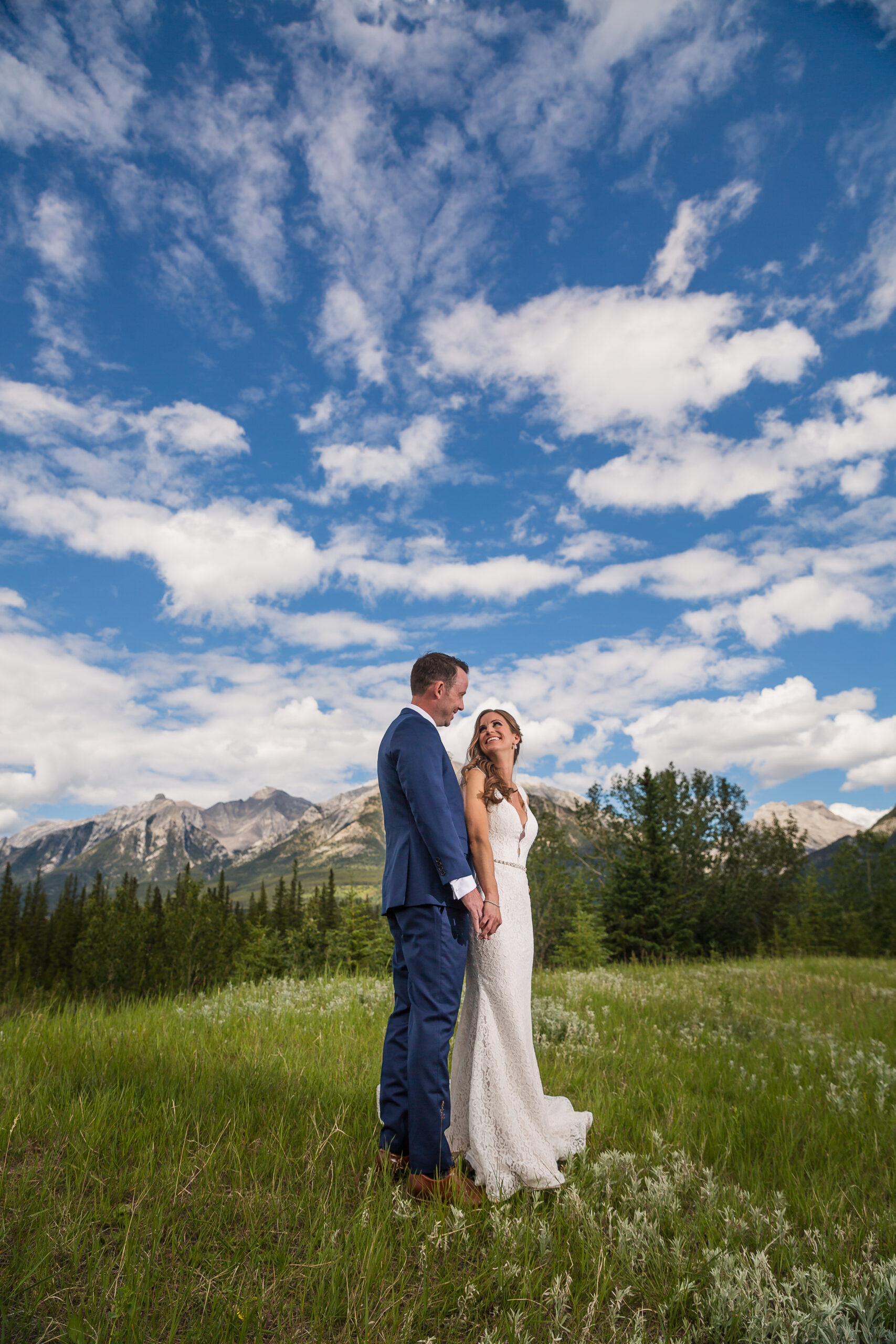 Bride and groom under a blue sky