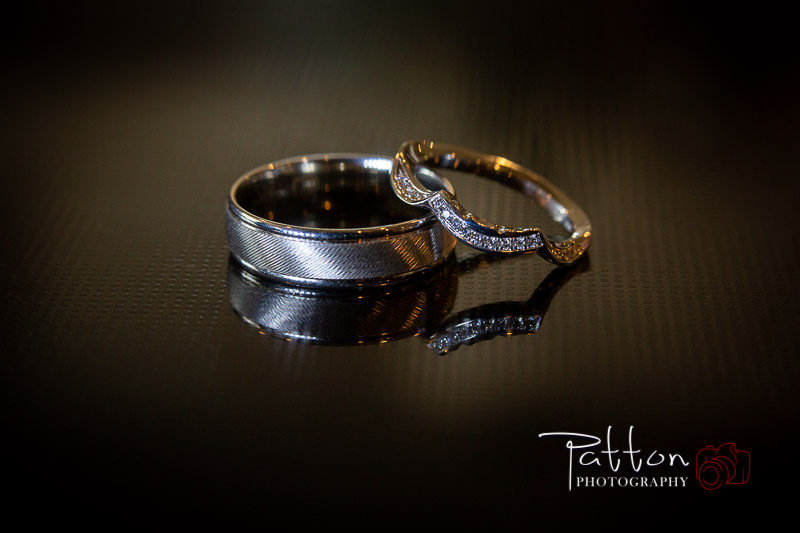 Calgary wedding rings detail shot on textured surface