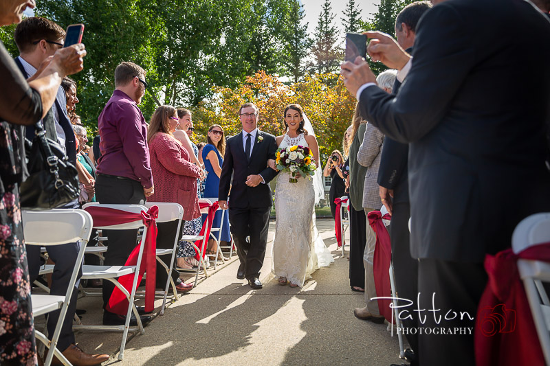 Calgary bride and father walking down aisle at incredible Valley Ridge Golf Club