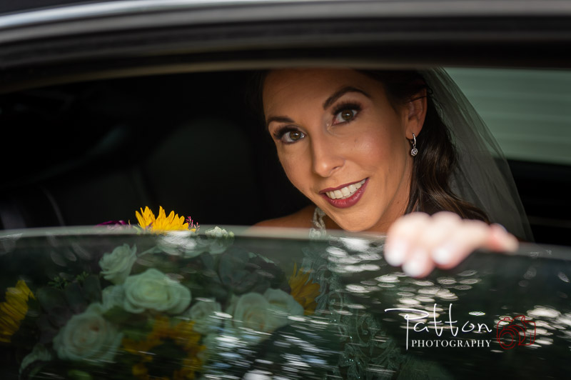 Calgary bride looking out of limo window at incredible Valley Ridge Golf Club