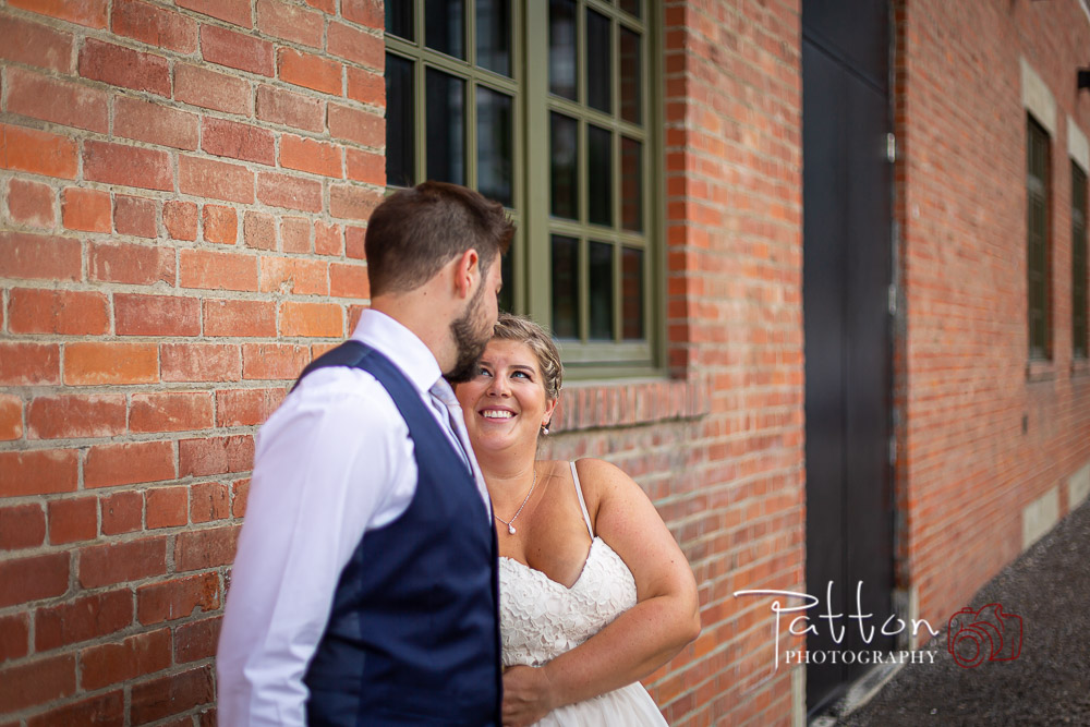 Calgary bride and groom in East Village next to wall - Fish Creek wedding