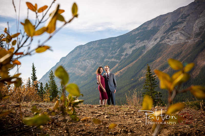 Calgary engagement couple standing in the mountains