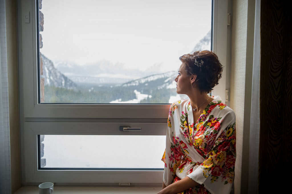 Bride in Banff next to window