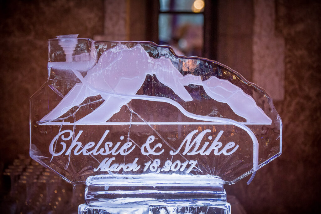 Custom ice sculpture at wedding bar
